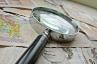 """British Money and Magnifying Glass"" by Images_of_Money"