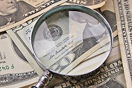 """Money and Magnifying Glass"" by Images_of_Money"